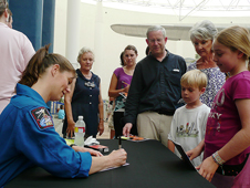 NASA Astronaut Tracy Caldwell signs autographs