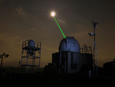 Goddard's Laser Ranging Facility aiming laser toward LRO