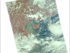Tropical Depression 14W (right center round area of clouds) on September 9 at 2:05 a.m. EDT.