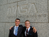 Greg (l) and Reid (r) standing in front of the NASA Headquarters building.