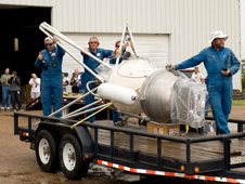 The launch vehicle rolls out of the Armadillo Aerospace hangar