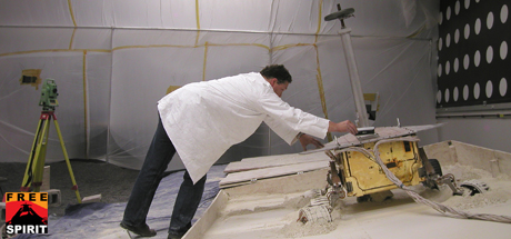 A rover team member checks the tilt of the lightweight test rover at NASA's Jet Propulsion Laboratory
