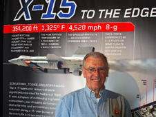 Joe Engle standing in front of the X-15 fabric exhibit.