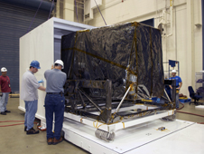 Engineers unloading The James Webb Space Telescope ISIM structure from its container