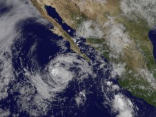 GOES-11 captured an image of Tropical Storm Marty (center) west of the Baja California peninsula.