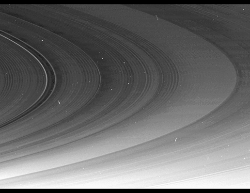 This mosaic of Cassini images shows that the spiral corrugation in the planet's inner rings continues right up to the inner B ring