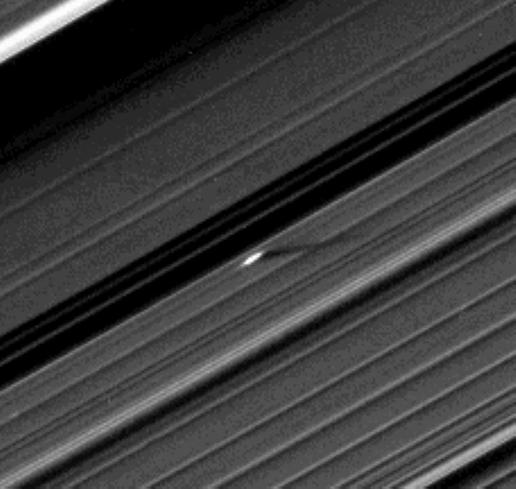 An unusually large propeller feature is detected just beyond the Encke Gap in this Cassini image of Saturn's outer A ring