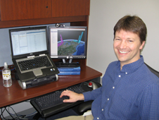 Tyler Erickson, a computer scientist at the Michigan Tech Research Institute, works on a program image