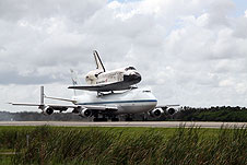 Discovery lands with its 747 Carrier Aircraft.