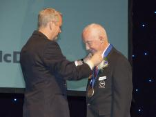 Retired NASA Apollo program astronaut James McDivitt (right) is presented with a medal by Ron Smith, vice-mayor of the City of Lancaster, Calif., at the city's Aerospace Walk of Honor induction ceremonies Sept. 19.