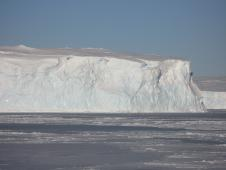 A 70-foot-tall Antarctic iceberg now adrift in sea ice.
