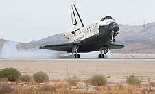 Space shuttle Discovery lands at Edwards Air Force Base in California.