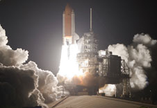 Space shuttle Discovery lifts off to begin the STS-128 mission.