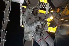 Astronaut Danny Olivas works outside the International Space Station.