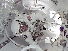 An astronaut exiting the airlock