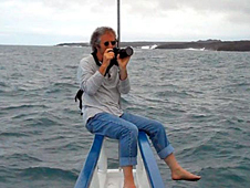 Gene Feldman with a camera on the front of a boat