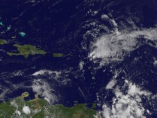 The image shows Henri as a disorganized area of clouds, located east of the Leeward Islands.