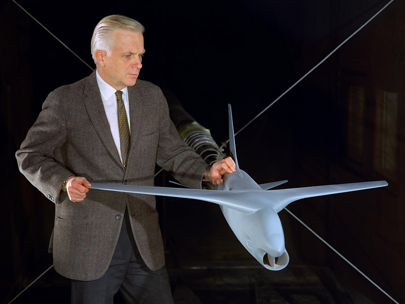 Richard Whitcomb looks over a model that incorporates his supercritical wing concept