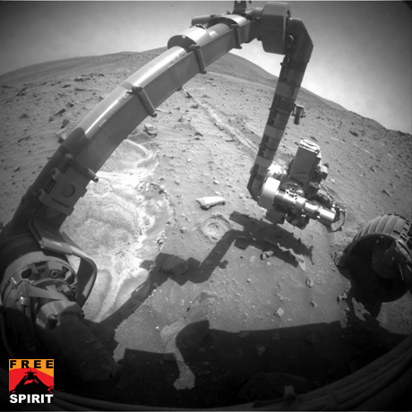 NASA's Mars Exploration Rover Spirit recorded this forward view of its arm and surroundings