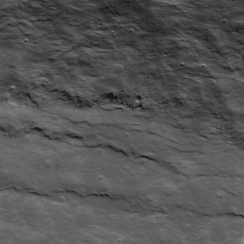 The distinctive wave like texture may look a little bit like a terrestrial beach, but it's actually impact ejecta on the rim of the crater Slipher S.
