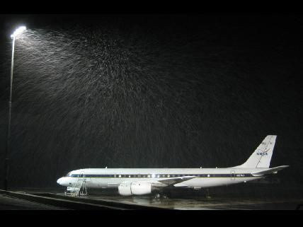 NASA DC-8 sits on the runway in the snow.