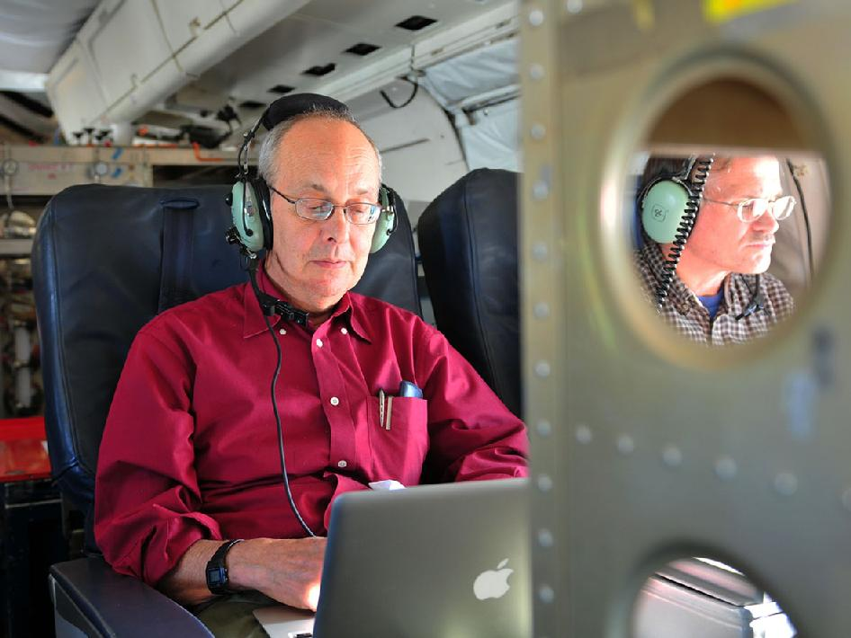 Seelye Martin studies data during the campaign's science flight to Pine Island Glacier.
