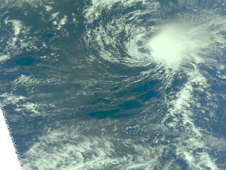 A visible image from AIRS of Neki, which appears as a tight round circle of clouds.