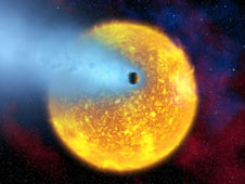 HD 209458's boiling atmosphere is being ripped from the planet as it orbits its star.