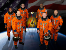 The crew of STS-129 in their orange launch and entry suits