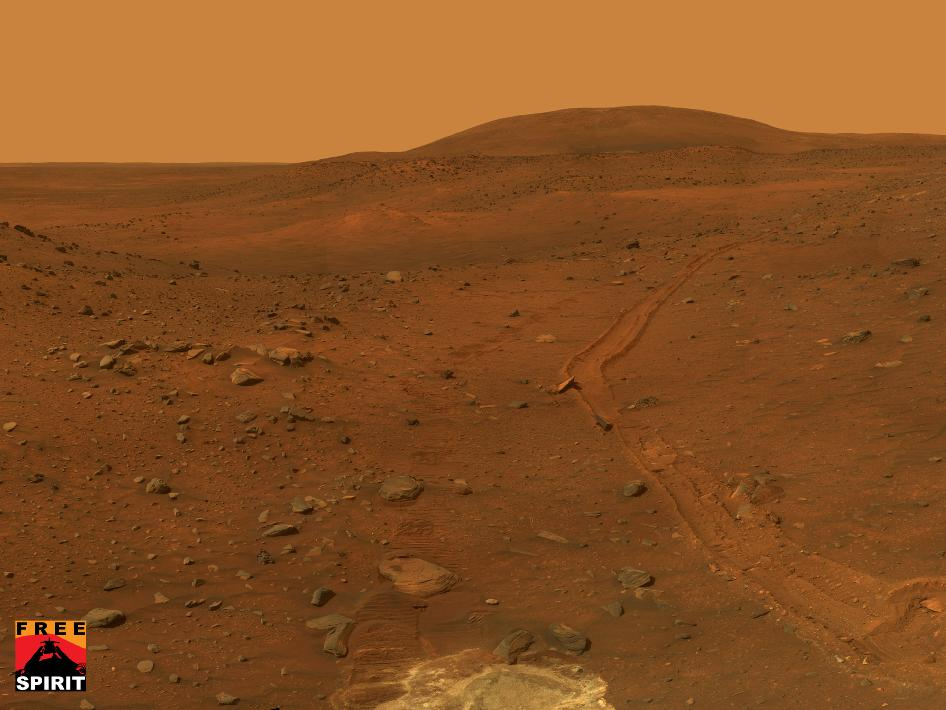 This view from the panoramic camera on NASAs Mars Exploration Rover Spirit shows the terrain surrounding the location called Troy, where Spirit became embedded in soft soil during the spring of 2009.