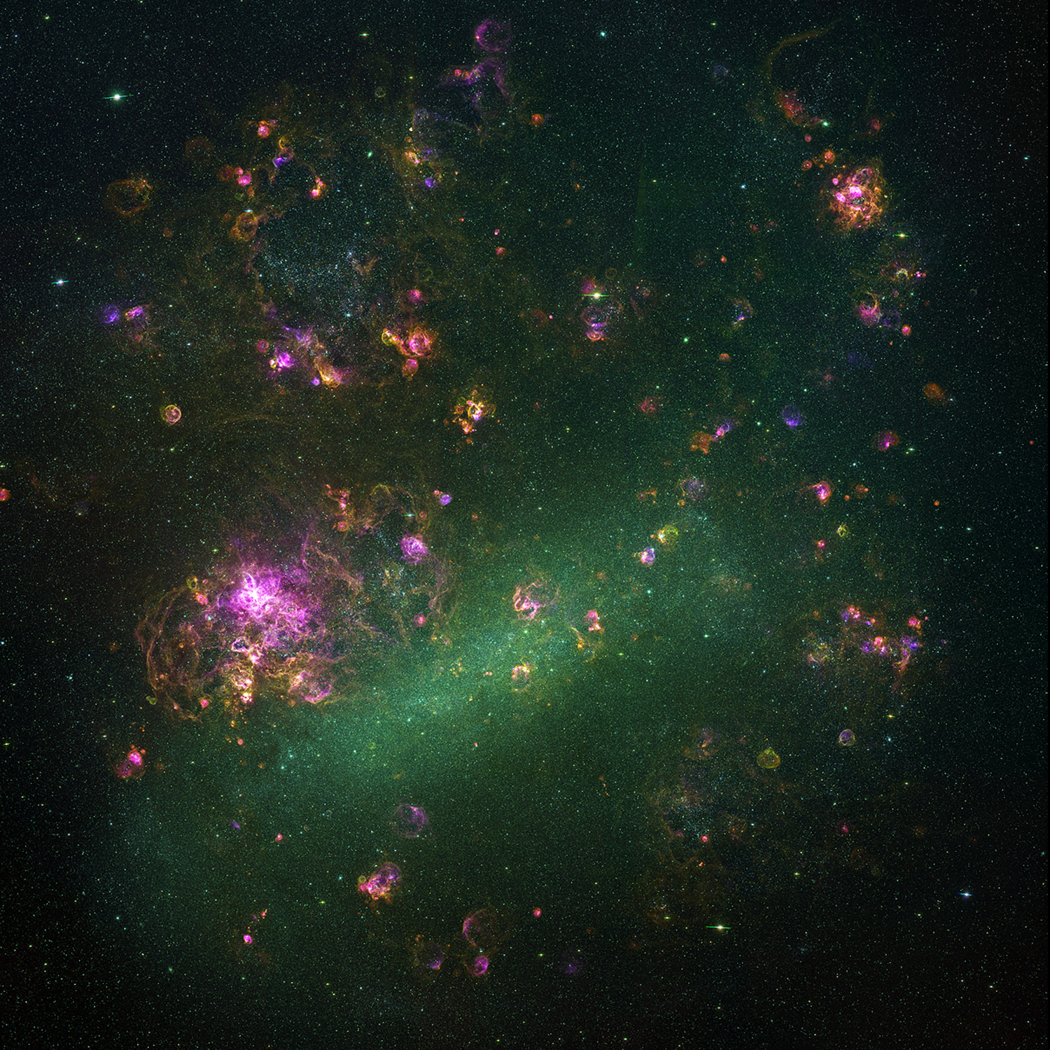 This mosaic of 1,500 images highlights glowing gas clouds in the Large Magellanic Cloud, a galaxy that orbits our own