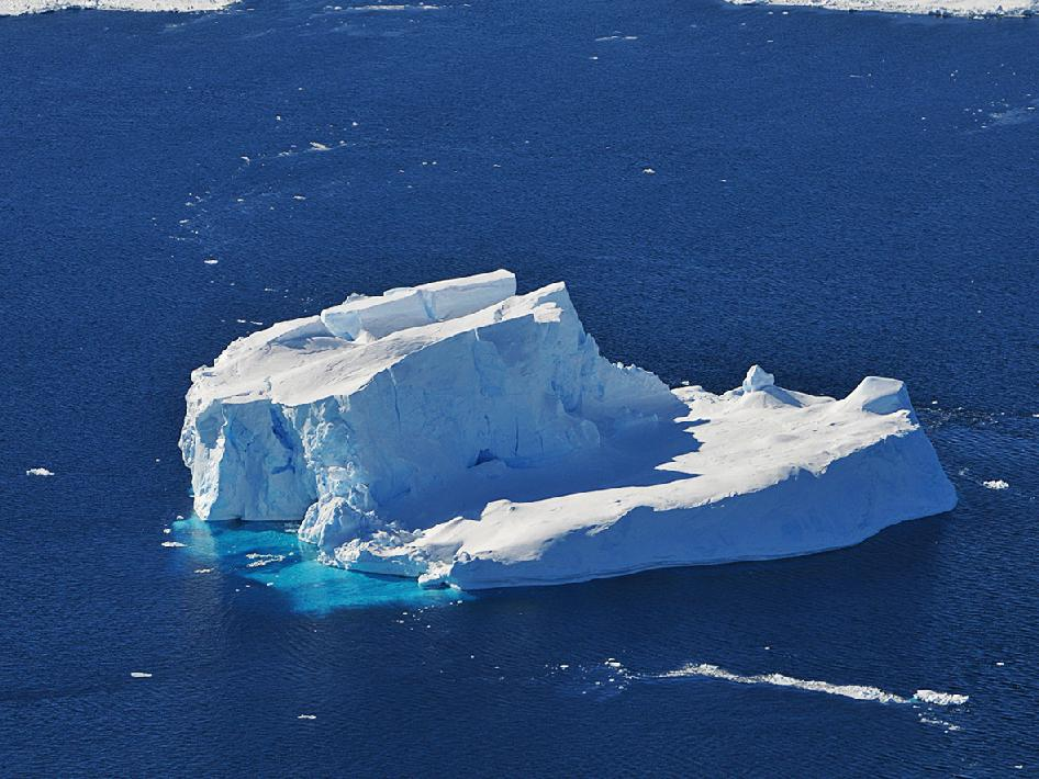 An iceberg is seen out the window of NASA's DC-8 research aircraft as it flies 2,000 feet above the Amundsen Sea in West Antarctica on Wednesday, Oct., 21, 2009.