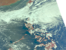 97W, showed clouds are already spreading over the northern Philippines.