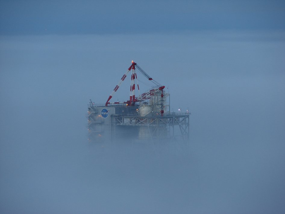 the A-2 Test Stand peered out from a thick blanket of fog during the early morning hours of Oct. 28, 2009. This photo was taken from the top of the B Test Stand.
