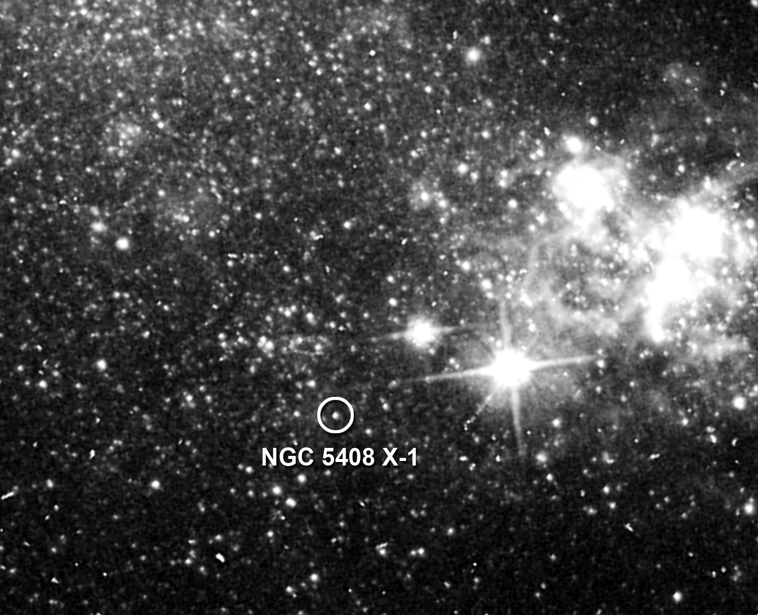 This archival image taken by the Hubble Space Telescope shows the location of NGC 5408's unusually luminous X-ray source (circled)