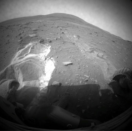 Wheel slippage during attempts to extricate NASA's Mars Rover Spirit from a patch of soft ground during the preceding two weeks had partially buried the wheels by the 1,899th Martian day, or sol, of the Spirit's mission on Mars (May 6, 2009).