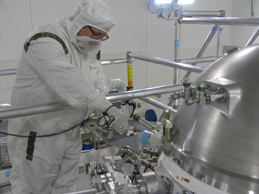 An engineer loads hydrogen gas into the Wide-Field Infrared Survey Explorer, or WISE, in a clean room at the Vandenberg Air Force Base, Calif.