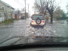 A jeep trying to get down a flooded street in Chincoteague, Virginia.