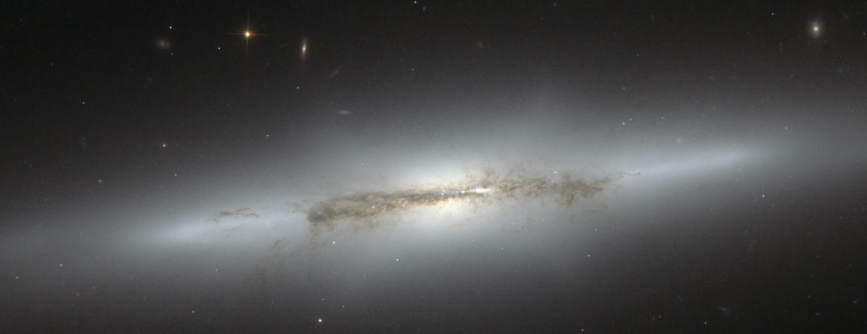 Galaxy NGC 4710 is tilted nearly edge-on to our view from Earth