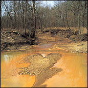 Missouri stream colored by runoff from a nearby mine