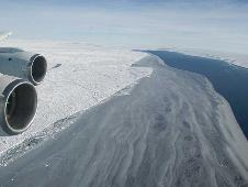 The edge of the Larsen Ice Shelf meets open water and sea ice, viewed from above during the 20th Ice Bridge flight in Antarctica.