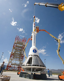 Orion mockups and Launch Abort System adjacent to the launch gantry