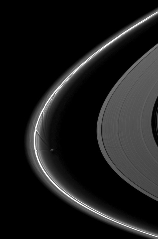 Saturn and its moon Prometheus