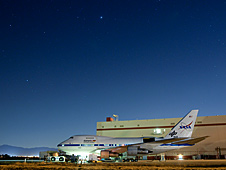 SOFIA's 747SP sits under a canopy of stars outside NASA's Dryden Aircraft Operations Facility in Palmdale, Calif