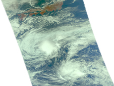 This NASA visible AIRS satellite image shows Nida (top left) looking elongated, almost like a cocoon.