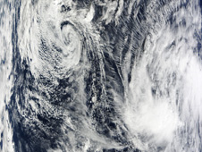 Tropical Depression Nida (top left) on December 3 at 1:35 UTC and System 97W (bottom right).