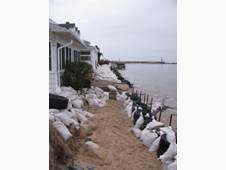 These pictures, taken Thanksgiving Day, show ongoing sandbagging operations to fortify the homes.