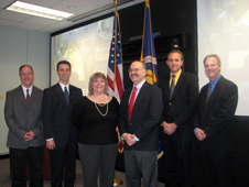 Paul and Ellen Roberts (center), flanked by Perry Wagner, Chip McCann, Mike Kirsch and Jeff Stewart (L to R)