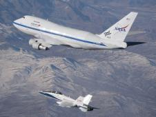 An F/A-18 mission support aircraft shadows NASA's Stratospheric Observatory for Infrared Astronomy 747SP during a functional check flight Dec. 9, 2009.