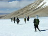 Photo of researchers hiking into the Himalayas to collect ice cores